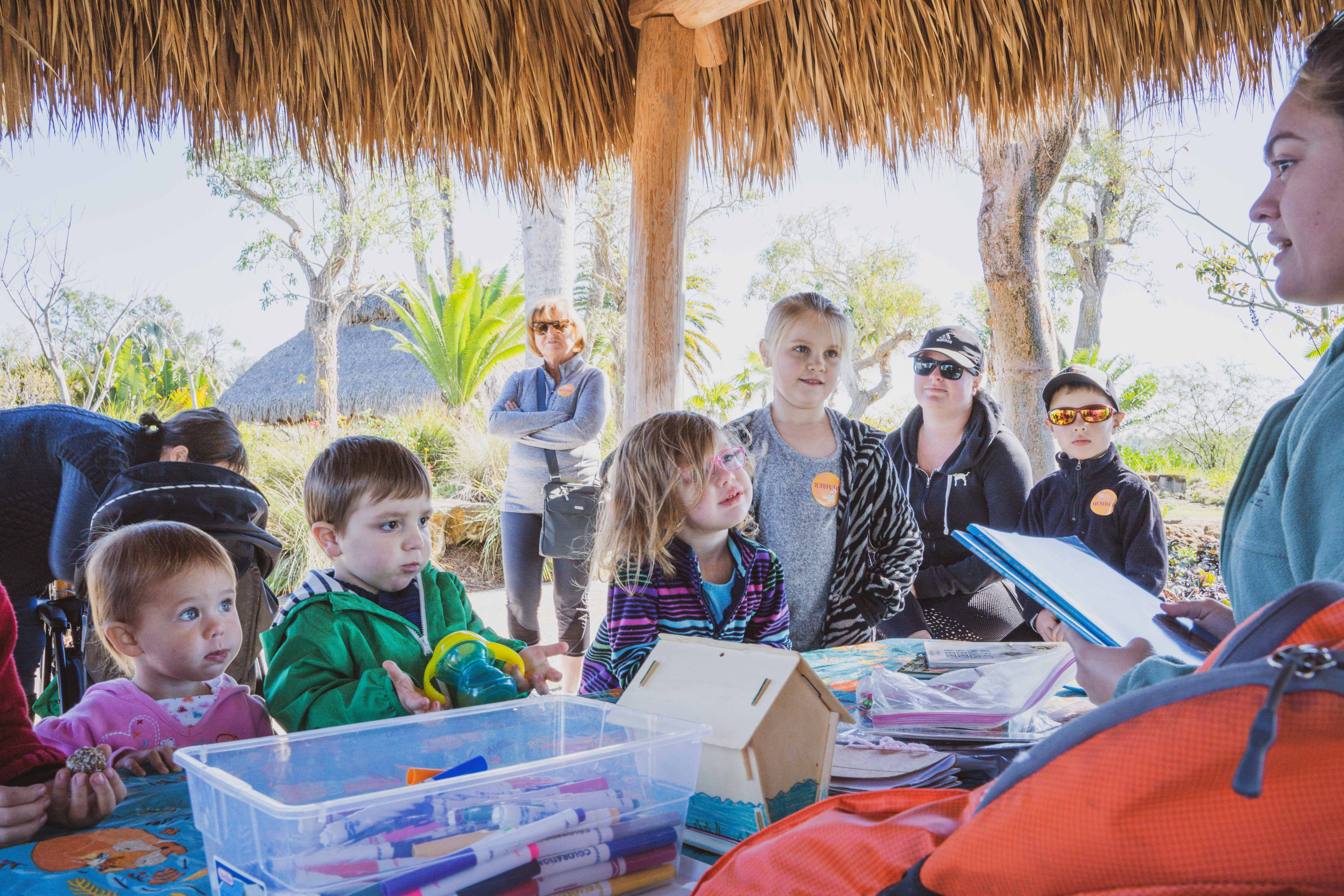 Naples Botanical Garden Employee interacts with family in Education program W.O.N.D.E.R.