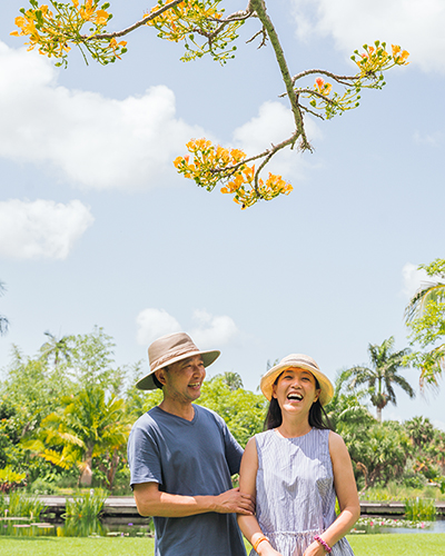 happy couple with flowering tree